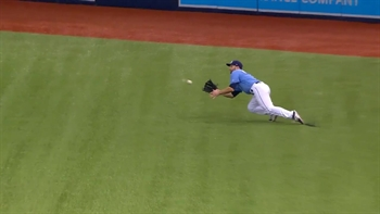 WATCH: Shane Peterson makes a diving catch to rob Carlos Correa