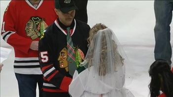 Forbidden Love: Wild and Blackhawks fans get married