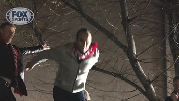Landon Donovan jumps off taco truck at American Outlaws rally