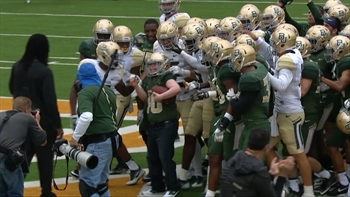 A long-time Baylor staffer with down syndrome scored at their spring game