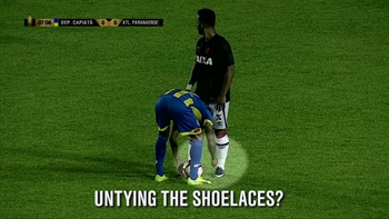 Player unties opponent's shoelaces during a match