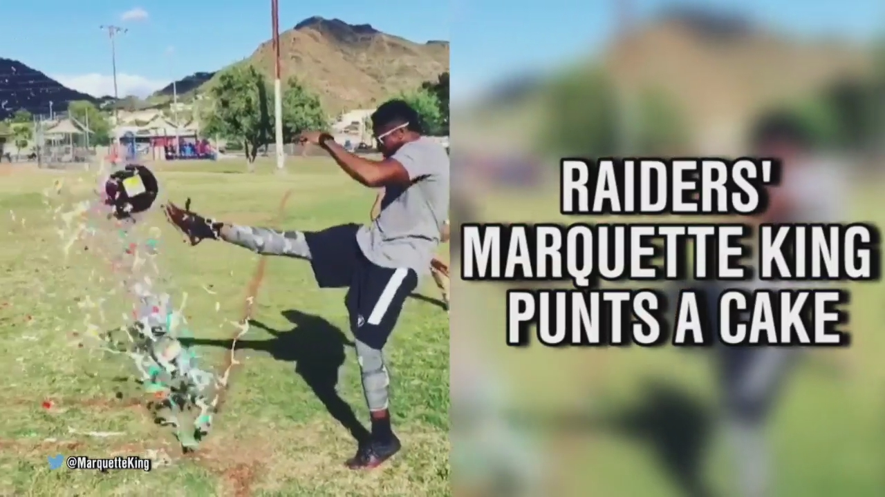 Marquette King punts a cake for Derek Carr's bday